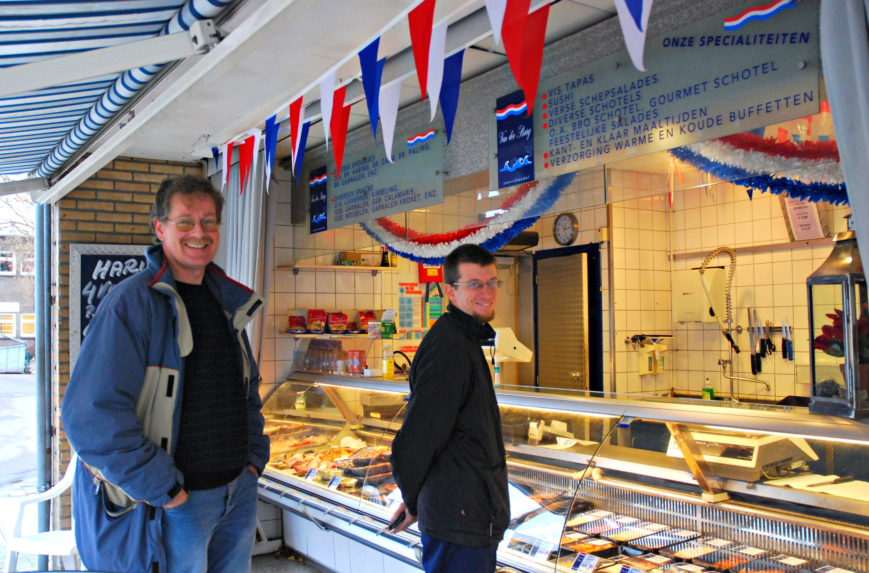 Mark and Andrew at the herring stall.